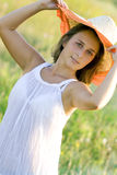Portrait young beautiful woman on field in summer Stock Image
