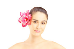 Portrait of young beautiful woman with flower in her hair. Isolated on white background Royalty Free Stock Photo