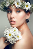Portrait of young beautiful woman with flowers Stock Photography