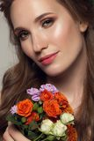 Close up portrait of young beautiful woman with flowers. Royalty Free Stock Images