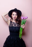 Portrait of a young beautiful woman with flowers Royalty Free Stock Photography