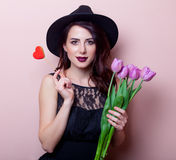 Portrait of a young beautiful woman with flowers and toy Stock Photo