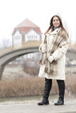 Portrait of a young and beautiful woman in a fur coat with cap a Royalty Free Stock Photos