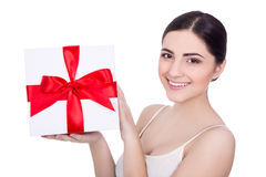 Portrait of young beautiful woman with gift box isolated on whit Royalty Free Stock Images