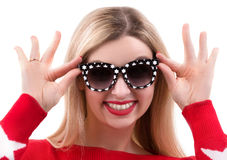 Portrait of young beautiful woman in glasses from the sun. Young beautiful woman in glasses from the sun stock image