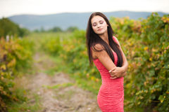 Portrait of young beautiful woman in grapes. Young beautiful woman in grapes royalty free stock images