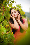 Portrait of young beautiful woman in grapes. Young beautiful woman in grapes stock photos