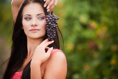 Portrait of young beautiful woman in grapes. Young beautiful woman in grapes stock image