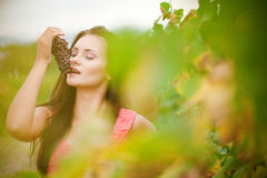 Portrait of young beautiful woman in grapes. Young beautiful woman in grapes royalty free stock image