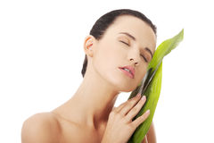 Beautiful woman with green exotic leaf stock images