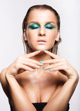 Portrait of young beautiful woman with green wet shining makeup Royalty Free Stock Photography