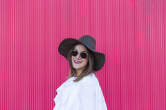 Portrait a young beautiful woman with hat and sunglasses over re royalty free stock photo
