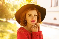 Portrait of a young beautiful woman in a hat on a Sunny autumn day stock photo