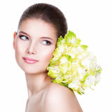 Portrait of young beautiful woman with a healthy clean skin. Stock Photos