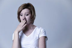 Portrait young beautiful woman on her 30s sad and depressed in breakdown suffering depression Stock Photo