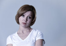 Portrait young beautiful woman on her 30s sad and depressed in breakdown suffering depression Stock Image