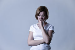 Portrait young beautiful woman on her 30s sad and depressed in breakdown suffering depression Royalty Free Stock Image