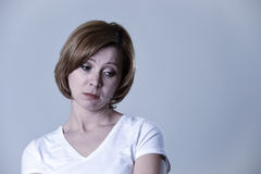 Portrait young beautiful woman on her 30s sad and depressed in breakdown suffering depression. Head and shoulders portrait of young beautiful woman on her 30s Stock Image