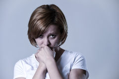 Portrait young beautiful woman on her 30s sad and depressed in breakdown suffering depression. Head and shoulders portrait of young beautiful woman on her 30s Royalty Free Stock Photos