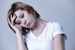 Portrait young beautiful woman on her 30s sad and depressed in breakdown suffering depression. Head and shoulders portrait of young beautiful woman on her 30s Royalty Free Stock Image