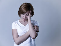 Portrait young beautiful woman on her 30s sad and depressed in breakdown suffering depression. Portrait of young beautiful woman on her 30s sad thinking Stock Photography