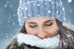 Portrait of young beautiful woman from his eyes closed in the winter snowing.  stock image