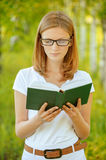 Portrait of young beautiful woman holding book Royalty Free Stock Images