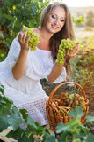 Portrait of young beautiful woman holding grapes Royalty Free Stock Photos