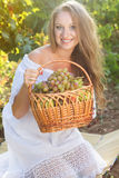 Portrait of young beautiful woman holding grapes Royalty Free Stock Photography