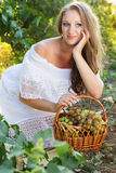 Portrait of young beautiful woman holding grapes Stock Images