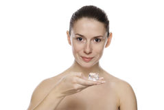 Portrait of young beautiful woman holding ice cube. Isolated on white background Royalty Free Stock Image