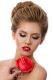 Portrait of young beautiful woman holding red rose Stock Photo