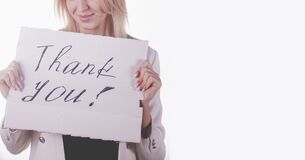 Portrait of young beautiful woman holding sign Thank You. Free space for design