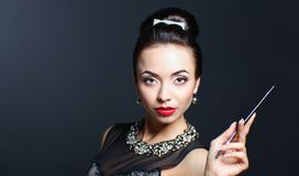 Portrait of young beautiful woman with jewelry stock photo