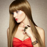 Portrait of young beautiful woman with jewelry Stock Photography
