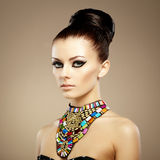Portrait of young beautiful woman with jewelry Royalty Free Stock Image