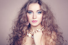 Portrait of young beautiful woman with jewelry Royalty Free Stock Photo