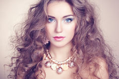 Portrait of young beautiful woman with jewelry Stock Photos