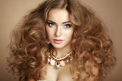 Portrait of young beautiful woman with jewelry Royalty Free Stock Photos