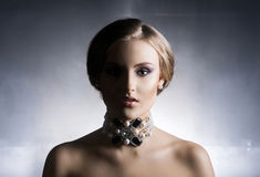 Portrait of young, beautiful woman in jewelry Royalty Free Stock Images