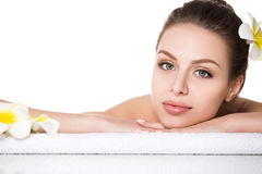 Portrait of young beautiful woman laying in spa salon Royalty Free Stock Photos