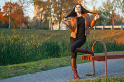 Portrait of the young beautiful woman in leather boots in the p. Full figure glamourous portrait of the young beautiful woman in leather boots in the park Stock Photography