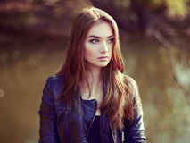 Portrait of young beautiful woman in leather jacket. Fashion photo Stock Photos