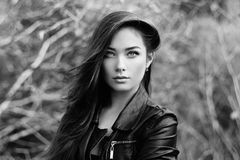 Portrait of young beautiful woman in leather jacket Royalty Free Stock Image