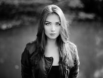 Portrait of young beautiful woman in leather jacket. Fashion photo Stock Images