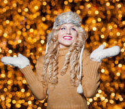 Portrait of young beautiful woman with long fair hair outdoor in a cold winter day. Beautiful blonde girl in winter clothes Royalty Free Stock Image