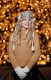 Portrait of young beautiful woman with long fair hair outdoor in a cold winter day. Beautiful blonde girl in winter clothes Royalty Free Stock Photo