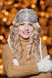 Portrait of young beautiful woman with long fair hair outdoor in a cold winter day. Beautiful blonde girl in winter clothes Royalty Free Stock Images