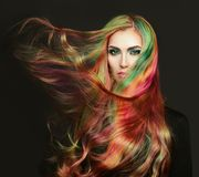 Portrait of young beautiful woman with long flying hair. Portrait of young beautiful woman with long flowing hair. Model with perfect Healthy Dyed Hair. Rainbow Royalty Free Stock Image