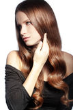 Perfect hair. Portrait of young beautiful woman with long glossy hair Stock Photos
